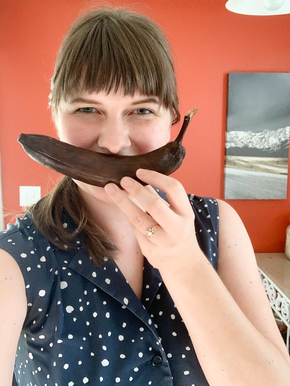 Jenica holding a brown banana ready for banana bread