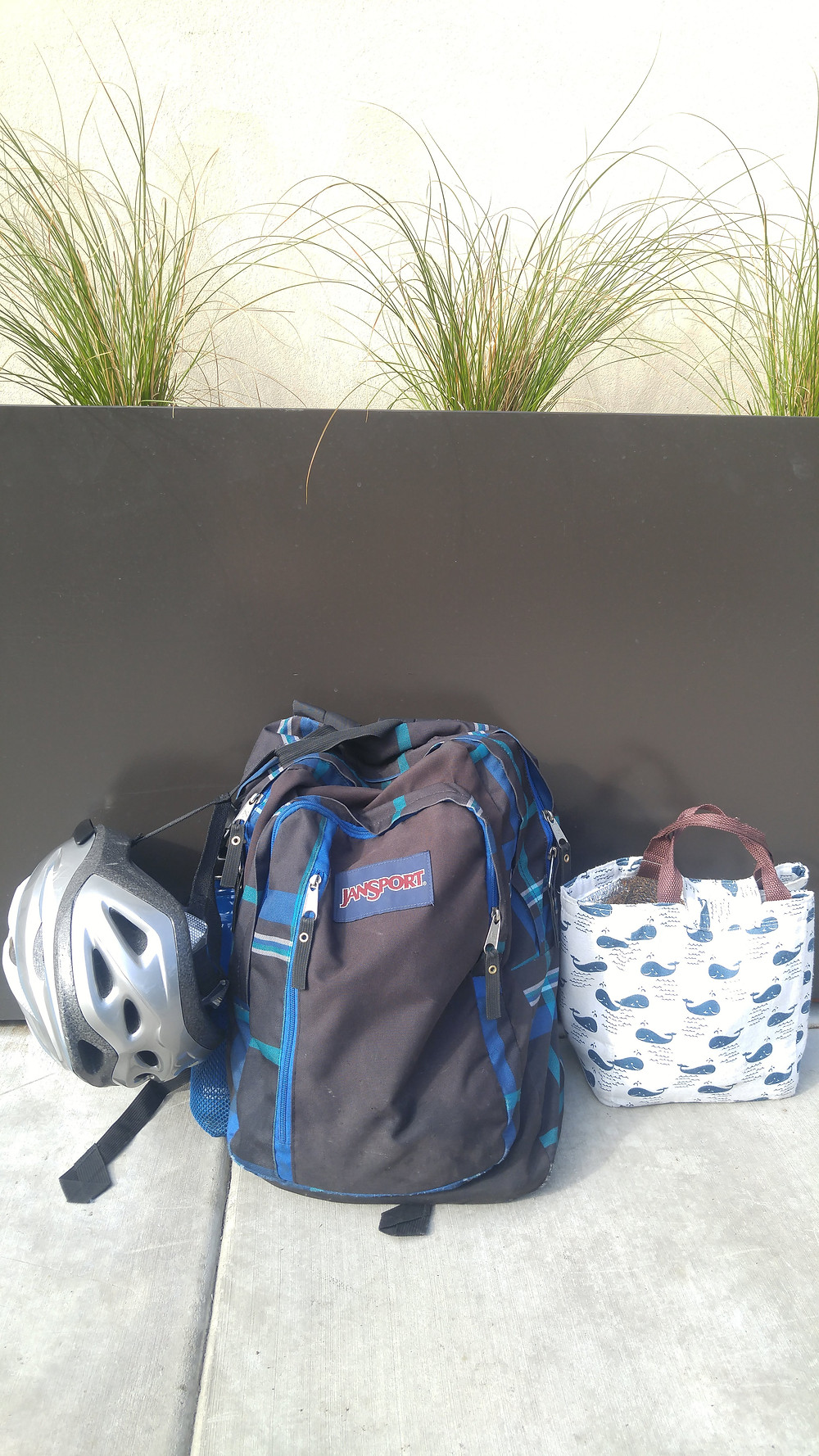 Backpack with bike helmet