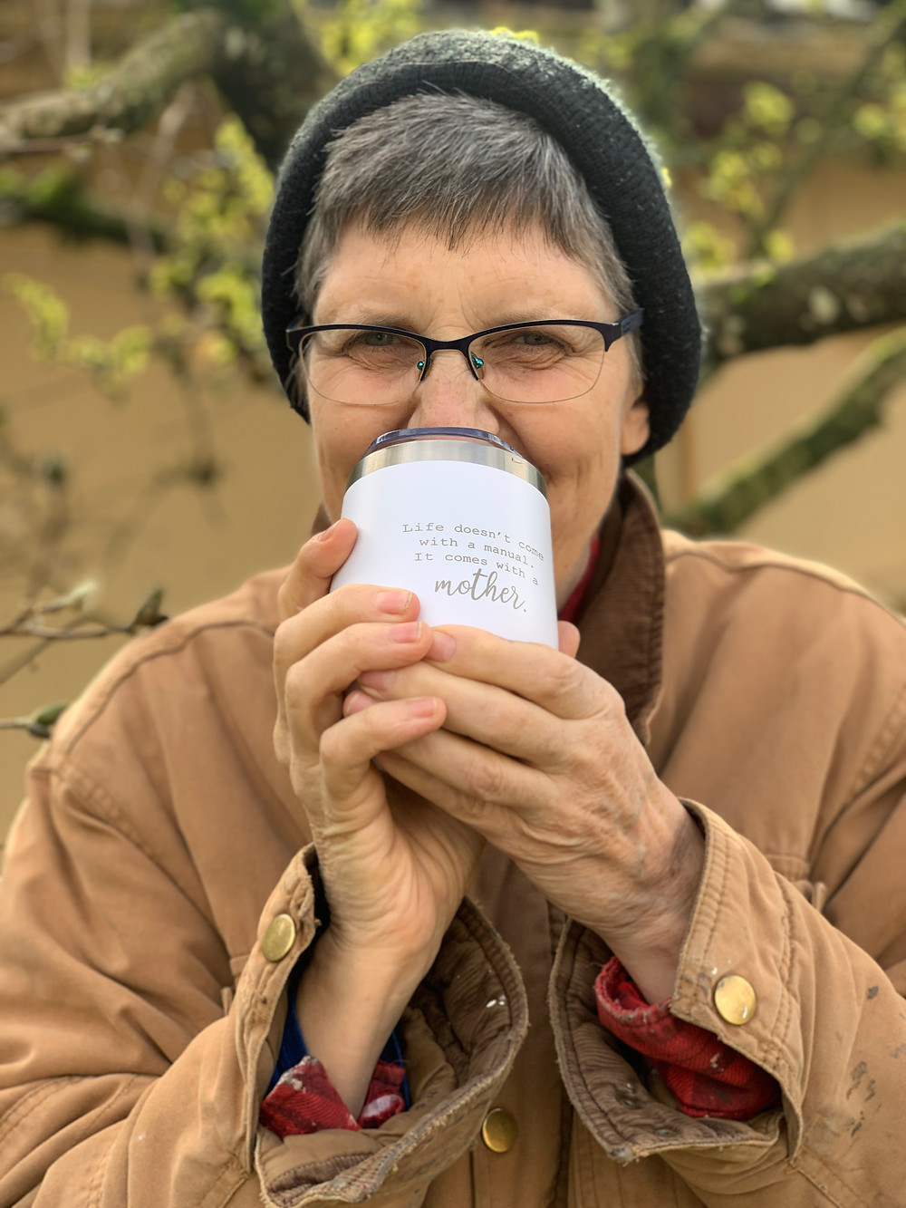 Mom holding a mother's day reusable cup