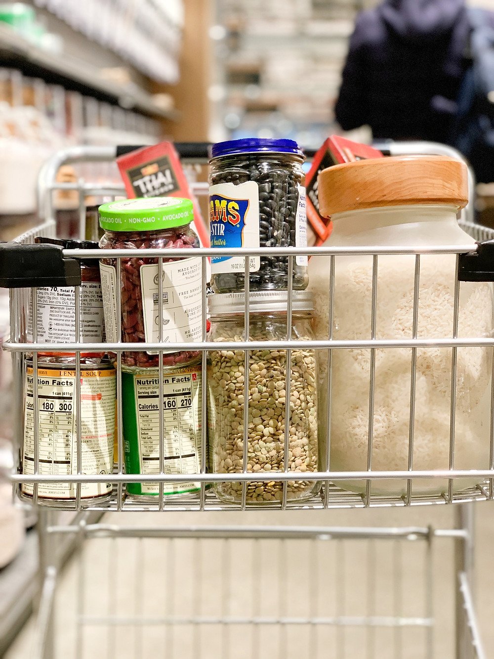 a shopping cart full of bulk foods