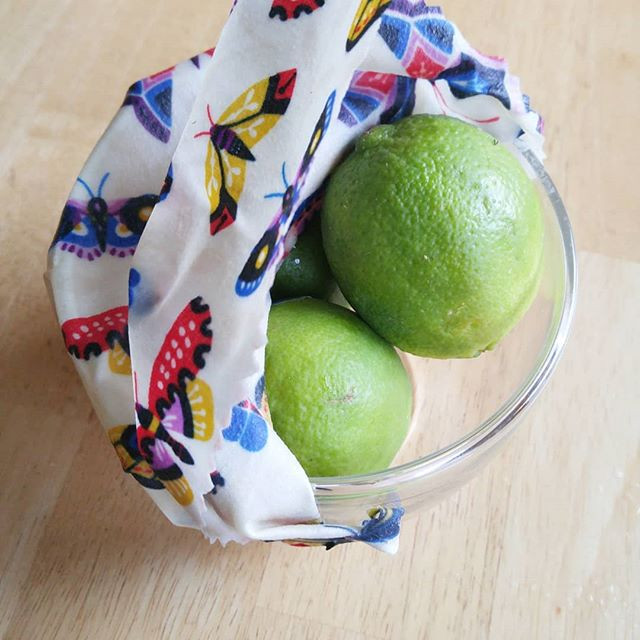 beeswax wraps covering a bowl of limes