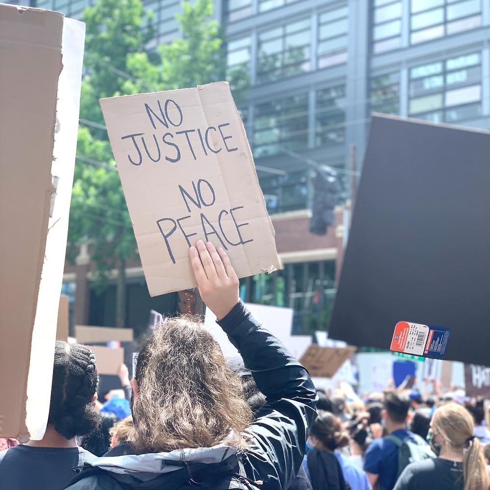 No Justice No Peace protester sign