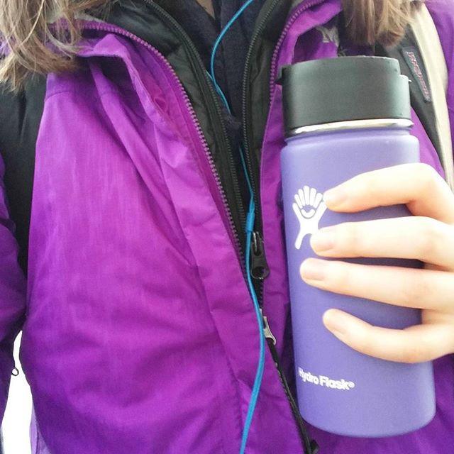 Jenica holding her reusable mug.
