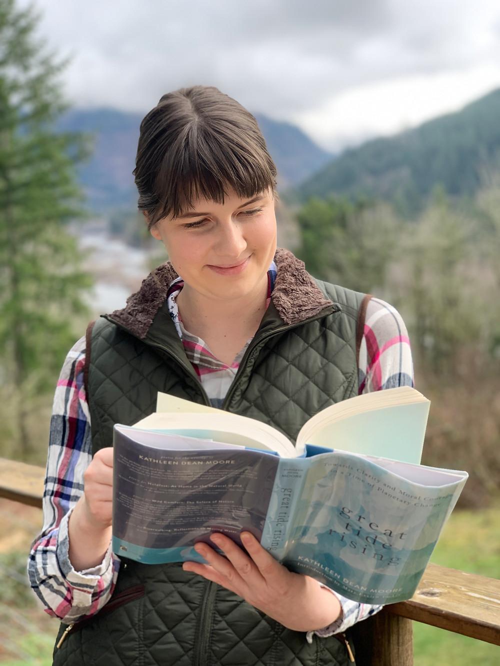 woman reading zero waste book