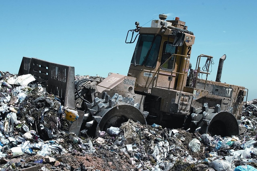 Bulldozer pushing trash