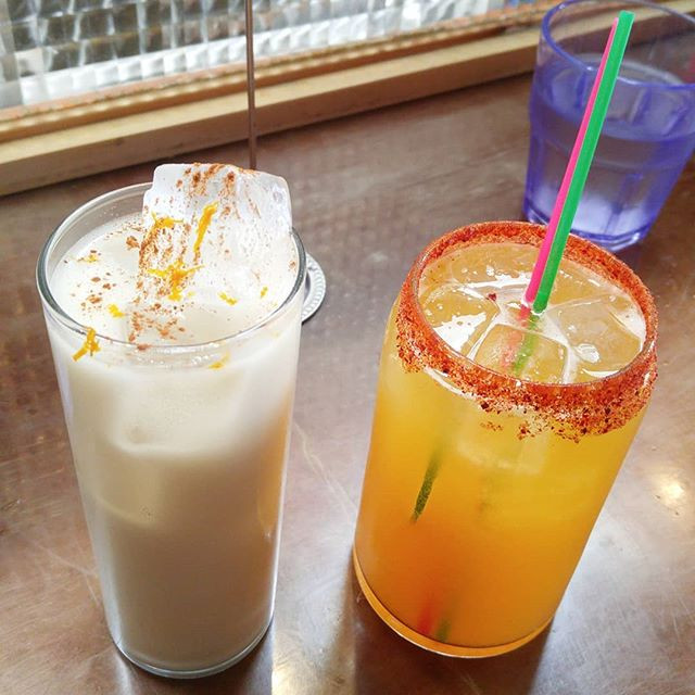 A drink without a straw compared to one with a straw.
