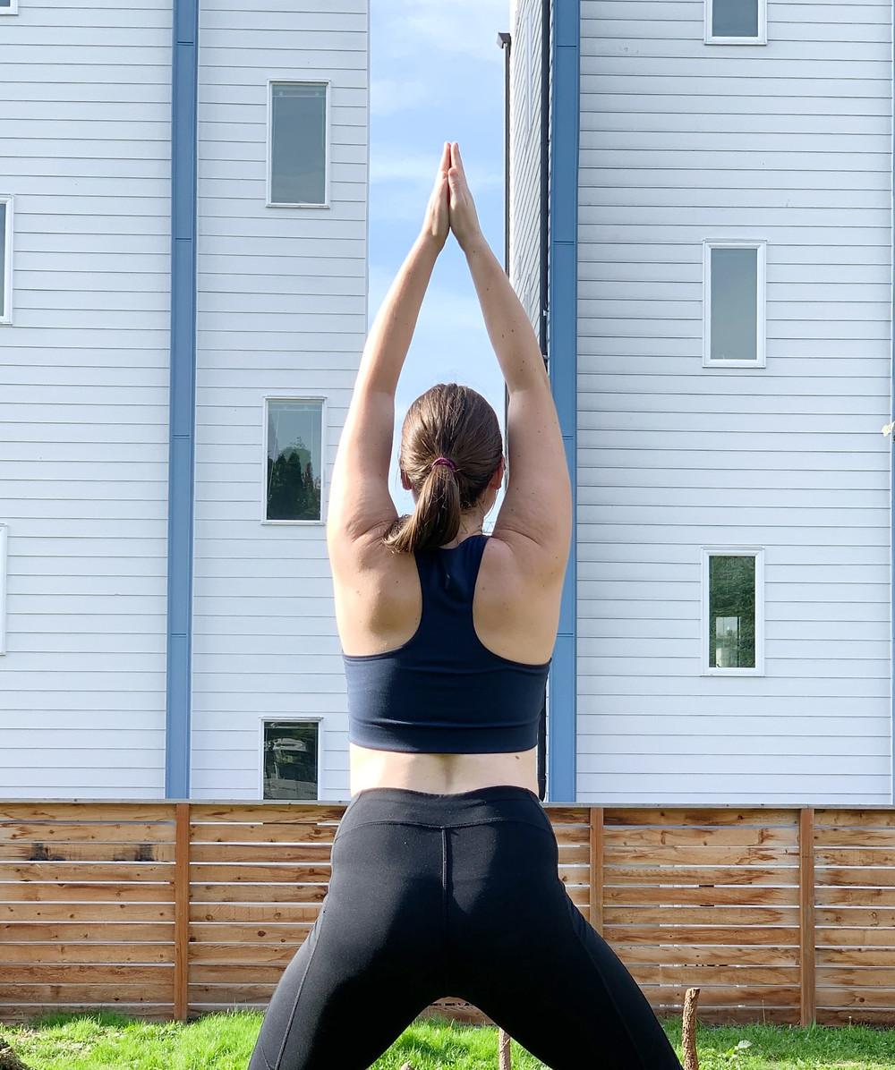 Jenica doing yoga in Girlfriend Collective bra
