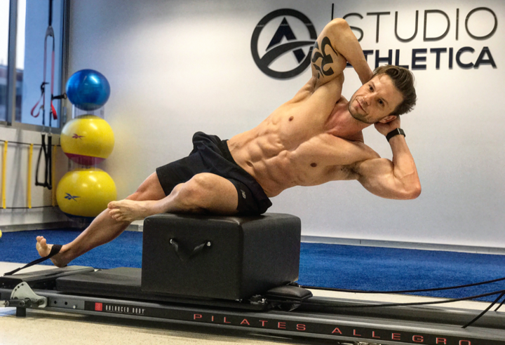 "Chris Demonstrating ""sides"" over the box on the Pilates reformer."
