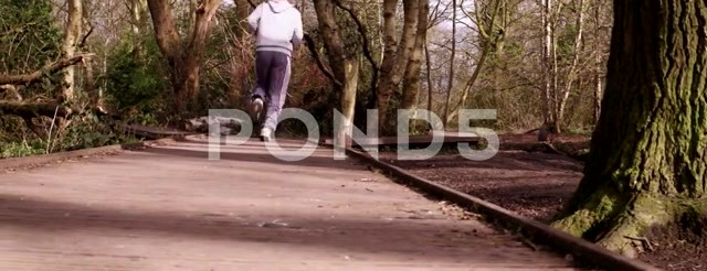 Young Man Running In The Woods Tracking Shots Sequence