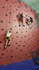 Kids Climbing on Auto Belay Rock Climbing Wall