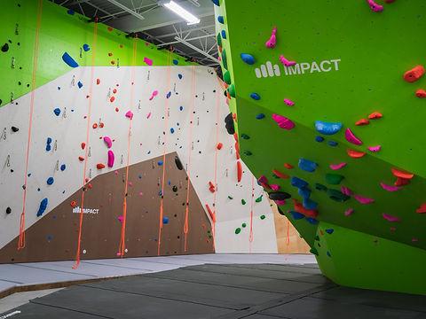 Impact rock climbing wall