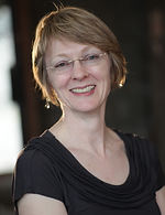 Dr Suzanne Bailey, headshot, smiling at camera