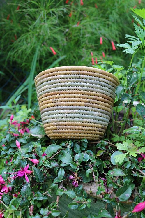 Small tan and seafoam green bowl