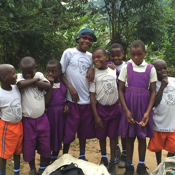 Batwa pygmy children wear school uniforms smiling and ready for school