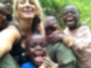 Redemption Song Foundation founder and director Wendee Nicole laughs with several Batwa children from Kalehe village in Southwest Uganda