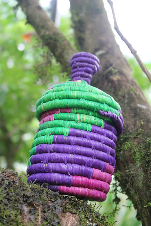 Pink, green and purple lidded basket