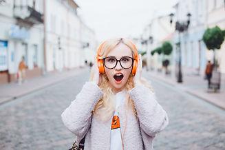young girl listening music in headphones