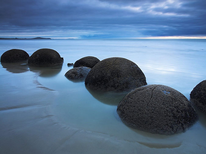 stones-balls-beach-clouds.jpg