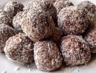 Organic dates rolled in Coconut