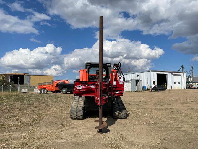 skid steer rotating pole handler.JPG