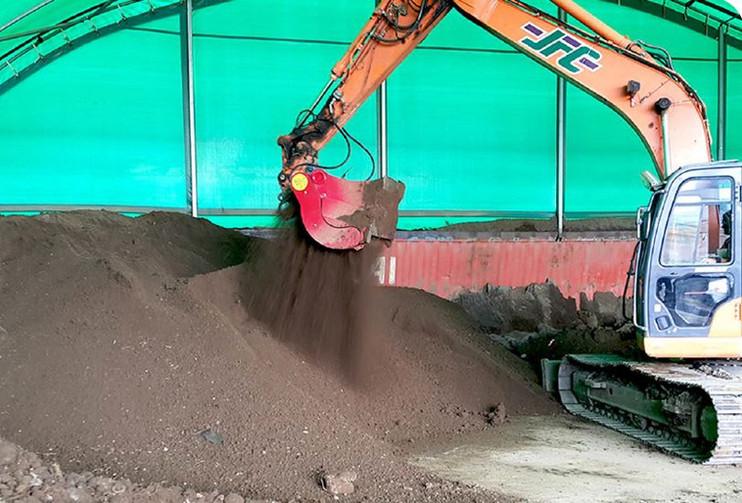 excavator in shed.JPG