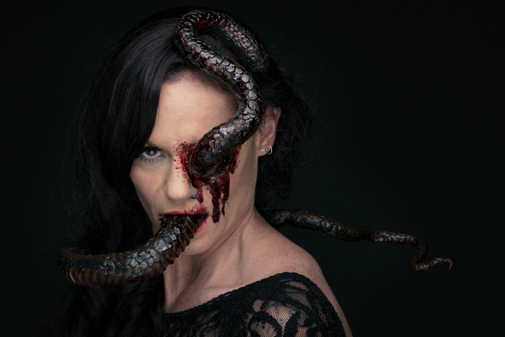 Created using a silicone prosthetic eye socket with hair-punched lashes and fake blood. Snake sculpted with Claytastic super light clay.   MUA: Sonja Howard Model: Erika Owen Photographer: Matt Leasegang