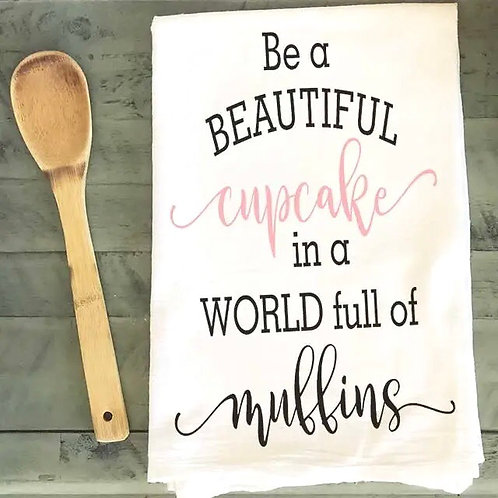 Be a beautiful cupcake in a world full of muffins dish towel