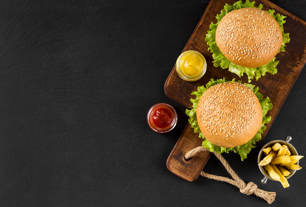 top-view-burgers-fries-cutting-board-wit