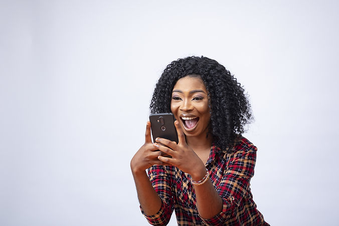 happy-young-african-female-using-her-pho