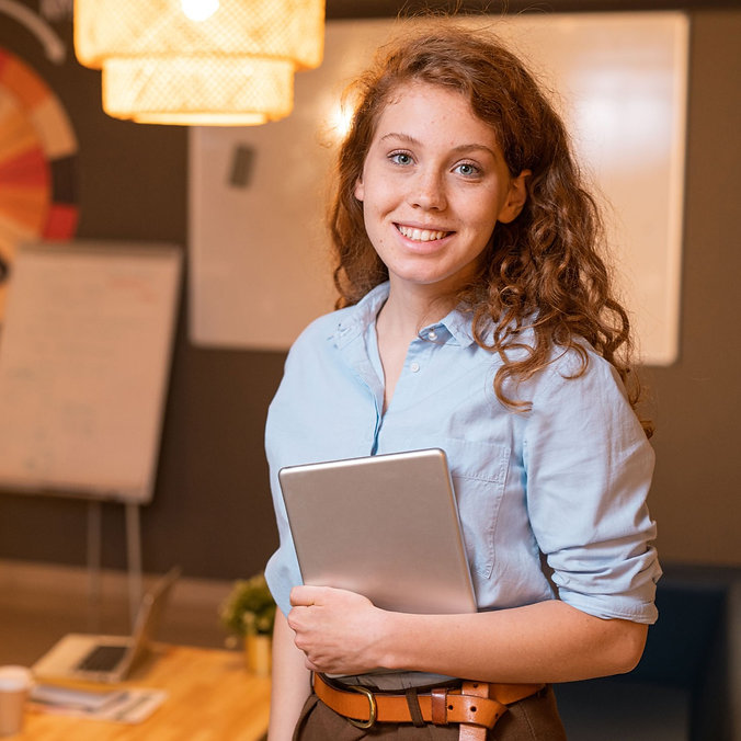young-successful-female-employee-with-to