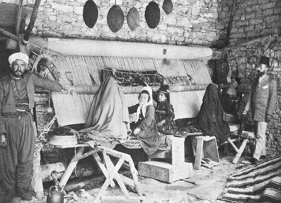Turkish_roller-beam_loom_and_weaversers.