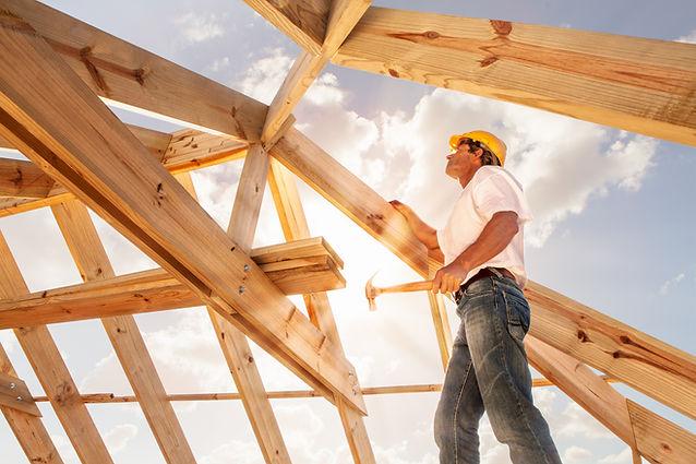 worker roofer builder working on roof s