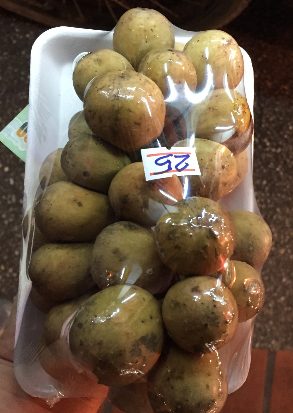 a 25 baht package of longkong or longan from a chiang mai night market in thailand