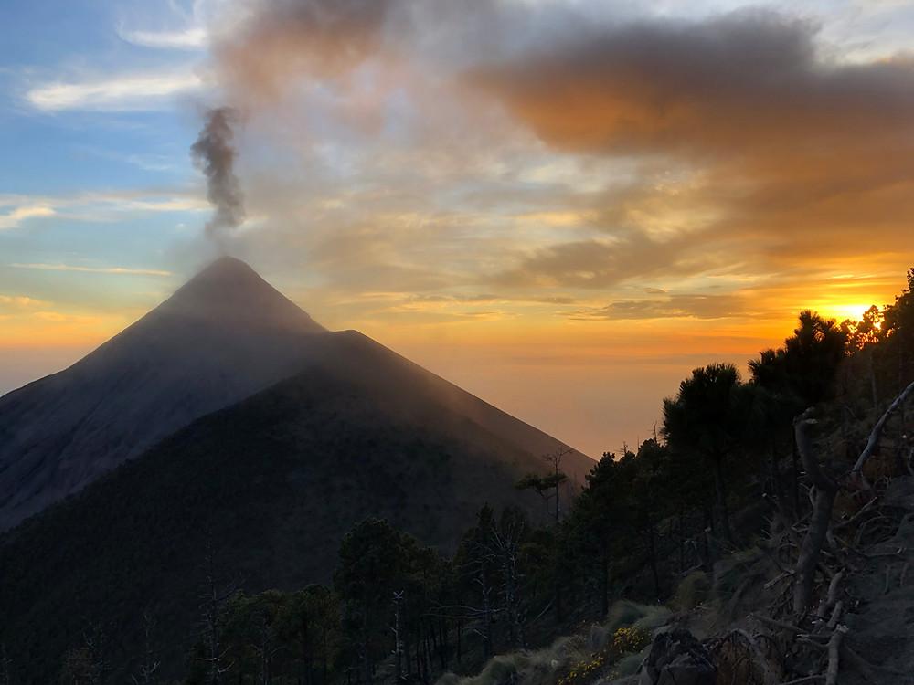 The Acatenango Volcano erupting at sunset near Antigua Guatemala