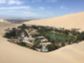 Sand dunes and oasis town in Huacachina Peru