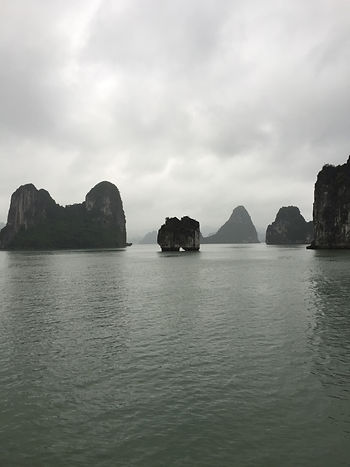 A cloudy day on Halong Bay at the Kissing Rock in Vietnam