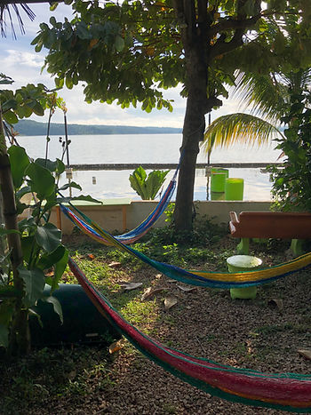 three hammocks at Cool Beans Cafe in Flores, Guatemala