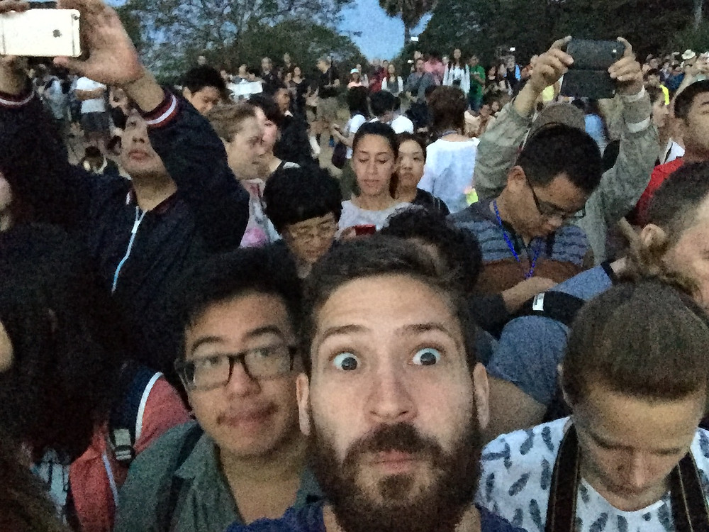 Two traveler friends taking a selfie at a crowded sunrise in the Angkor Wat