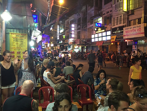 Travelers having a drink on Pham Ngu Lao Pub Street in Ho Chi Minh City, Vietnam