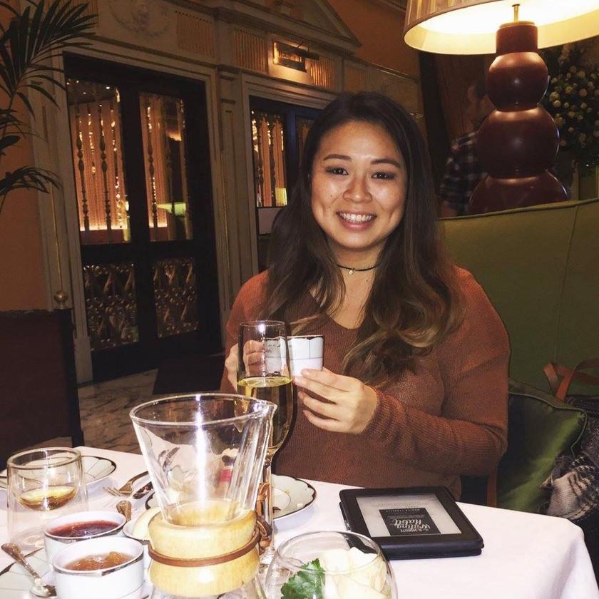 female solo traveler has high tea in london, U.K.
