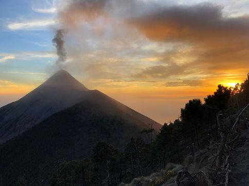 volcan fuego erupting smoke on the acatenango volcano hike near Antigua Guatemala during sunset