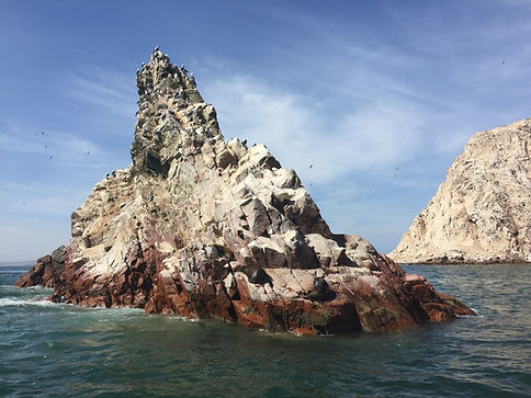 Rock formation at Islas Ballestas with sea lions and penguins in Paracas Peru