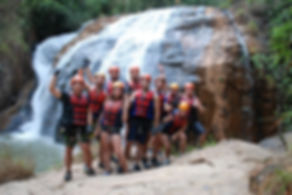 a group of travelers doing the canyoning tour in Dalat Vietnam