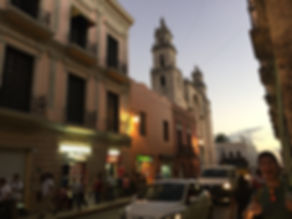 Sunset in Merida, Mexico with busy streets