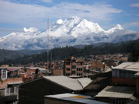 city view of Huaraz, Peru with glaciers and mountains in the background