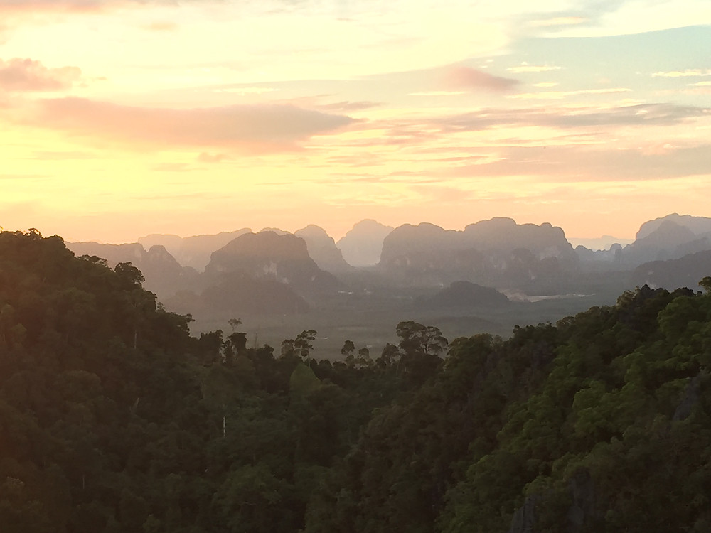 the beautiful sunset view from the top of the Tiger Cave Temple in Krabi Thailand
