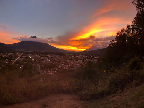 the mirador viewpoint overlooking Antigua Guatemala and Volcan Fuego during sunset