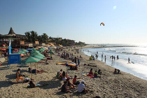 tourists enjoying the beach in Mancora, Peru