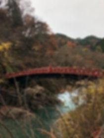 Shinkyo Bridge in Nikko on a cloudy day during Fall