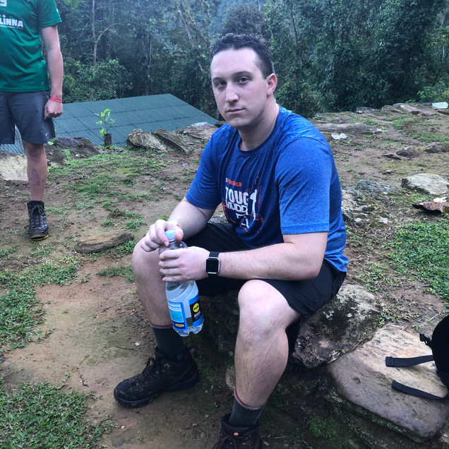 A tired and worn out American hiker in Colombias Lost City Trek in the Santa Marta's jungle region